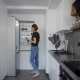 Alone Young Woman Is Getting Eggs From Fridge in Her Kitchen in Morning, Preparing for Cooking - VideoHive Item for Sale