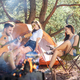 Party, camping of men and women group at forest. They relaxing, singing a song - PhotoDune Item for Sale
