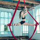 Graceful gymnast performing aerial exercise at loft - PhotoDune Item for Sale