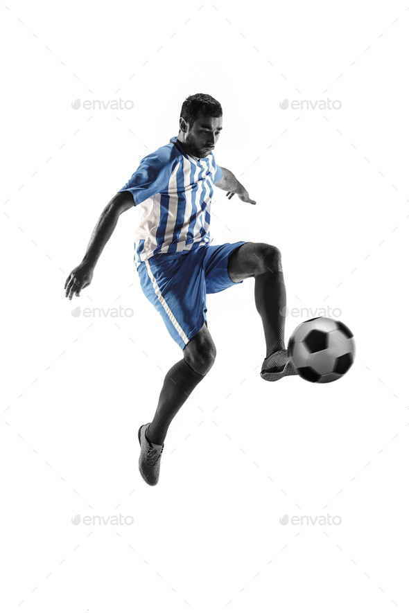 Professional football soccer player with ball isolated on white background - Stock Photo - Images