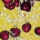 A Fresh Cherry Are Splashing Into Water on Yellow Background - VideoHive Item for Sale