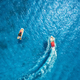 Aerial view of floating motorboat in transparent blue sea - PhotoDune Item for Sale