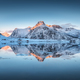 Fjord with reflection in water, snowy mountains at sunset - PhotoDune Item for Sale