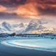Beautiful arctic sandy beach, sea and snowy mountains at sunset - PhotoDune Item for Sale