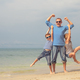 Father and children  playing on the beach at the day time. - PhotoDune Item for Sale
