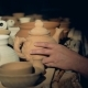 A Pottery Worker Checks Clay Jar, Touching Its Lip - VideoHive Item for Sale