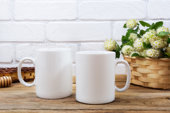 Two coffee mug mockup with basket of flowers - Stock Photo - Images