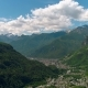 Aerial View of Yypical Alps Village in Green Hills and Valleys of Alps in Italy or Austria in - VideoHive Item for Sale