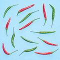 Food flatlay pattern of chili peppers on blue background - PhotoDune Item for Sale