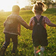 Friends Children Holding Hands and Running Together Along Summer Meadow at Sunset - VideoHive Item for Sale