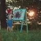 Little Boy Standing and Drawing on the Easel at Park - VideoHive Item for Sale
