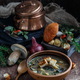 Mushroom soup in ceramic bowl with a copper pan and mushroom in background, dark photo. - PhotoDune Item for Sale