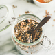 Buckwheat and chocolate granola with hazelnuts in glass jar - PhotoDune Item for Sale