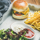 Beef burger, french fries, salad, suaces on tray, selective focus - PhotoDune Item for Sale