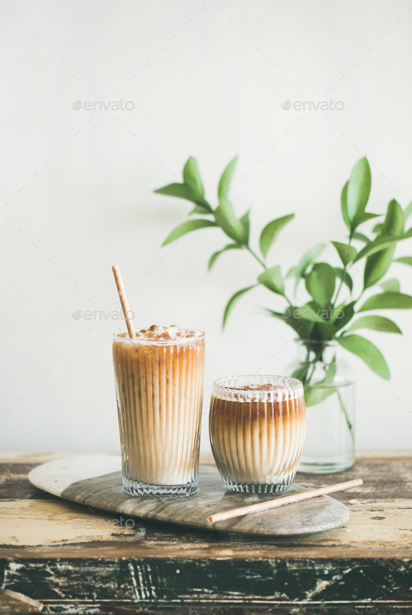 Iced coffee drink in tall glasses with milk and straws - Stock Photo - Images