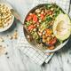 Flat-lay of vegan dinner bowl with avocado, grains, beans, vegetables - PhotoDune Item for Sale