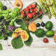 Flat-lay of fruit, vegetables and greens over white wooden background - PhotoDune Item for Sale