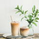 Iced coffee drink in tall glasses with milk and straws - PhotoDune Item for Sale