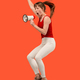Beautiful young woman jumping with megaphone isolated over red background - PhotoDune Item for Sale