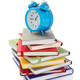 notebooks and alarm clock at white background - PhotoDune Item for Sale
