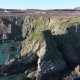Aerial View of the Beautiful Cliffs Close To the Historic South Stack Lighthouse on Anglesey - Wales - VideoHive Item for Sale