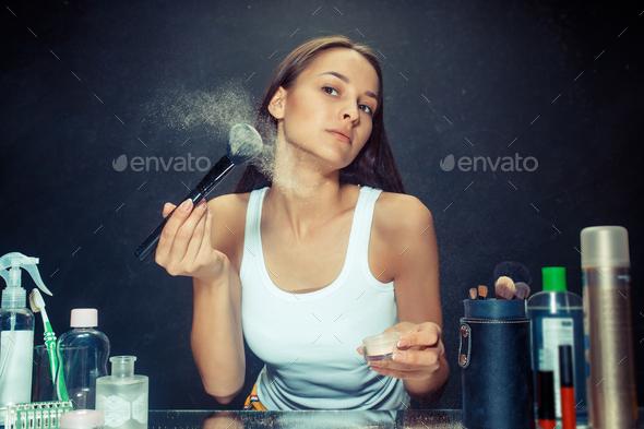 Beauty woman applying makeup - Stock Photo - Images