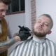 Shaving of Beard. Barber Cutting Men's Face Hair with Beard Trimmer at Barbershop - VideoHive Item for Sale