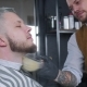Barber Sips Talc on a Brush. The Video Has a Brown Tint. - VideoHive Item for Sale