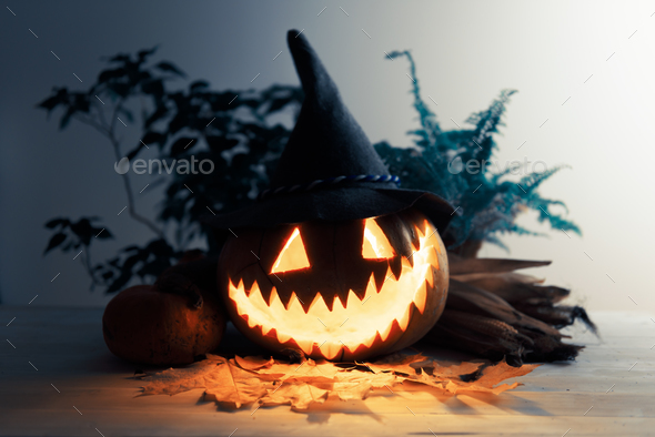 Scary traditional smiley pumpkin lantern - Stock Photo - Images