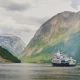 A Small Cruise Ship with Tourists Begins a Trip To the Fjord in Norway - VideoHive Item for Sale