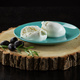 Mozzarella cheese and olives on piece of wood over black - PhotoDune Item for Sale