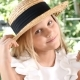 Portrait of Blond Attractive Girl Smiling, Touching Her Hair with a Straw Hat On. Lifestyle. Happy - VideoHive Item for Sale
