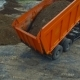 A Huge Truck Unloads a Mountain of Sand To Plant. Repairing Works Aerial View. - VideoHive Item for Sale