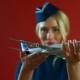 The Stewardess Smiling with a Toy Plane in Her Hands - VideoHive Item for Sale