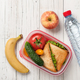 Lunch box with sandwich and tomatoes, water bottle, apple, banana - PhotoDune Item for Sale