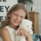 Sweet Girl Is Hugging a Teddy Bear, Looking at Camera and Smiling - VideoHive Item for Sale