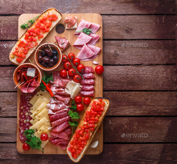 Meat and cheese appetizer set for red wine on rustic background, flatlay, copy space. - Stock Photo - Images