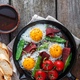 Fried eggs in a frying pan with cherry tomatoes, green peas and pastrami. Copyspace - PhotoDune Item for Sale