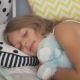 Cute Little Girl Sleeping with Teddy Bear in Bed - VideoHive Item for Sale
