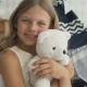 Cute Little Girl Is Hugging a Teddy Bear, Looking at Camera and Smiling - VideoHive Item for Sale