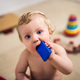 A toddler boy playing with wooden blocks at home. - PhotoDune Item for Sale