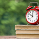 Back to school - old alarm clock on books - PhotoDune Item for Sale
