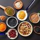 Top view of fflat lay of assortment of legumes on black tabletop background, in scoop, enameled bowl - PhotoDune Item for Sale