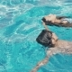 Two Happy Teenagers, a Brother and Sister, Swimming in the Pool - VideoHive Item for Sale