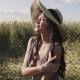 Beautiful Girl in Wheaten Field Posing Smiling at Camera. Portrait of a Young Attractive Woman - VideoHive Item for Sale