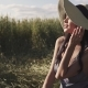 Portrait of a Young Beautiful Girl in a Straw Hat and Country Clothes in a Field. Attractive Girl - VideoHive Item for Sale