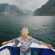 A Woman Is Standing on the Bow of the Ship Sailing Over the Fjord in Norway - VideoHive Item for Sale