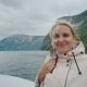 Portrait of a Happy Woman Sailing on a Cruise Ship on a Beautiful Fjord in Norway - VideoHive Item for Sale
