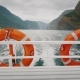 Cruise Ship Cruise with Two Lifebuoys. In the Background, the Picturesque Norwegian Fjord - VideoHive Item for Sale