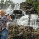 The Tourist Photographs the Highest Waterfall in Norway. According To Legend, the Water From This - VideoHive Item for Sale